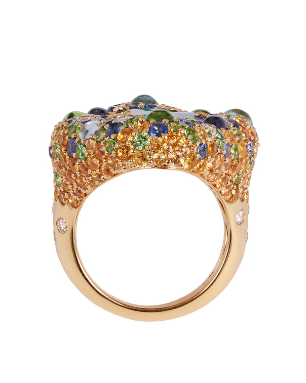 Opal ring, featuring a natural Queensland boulder opal, surrounded by a myriad of gemstones, crafted in 18 karat yellow gold.
