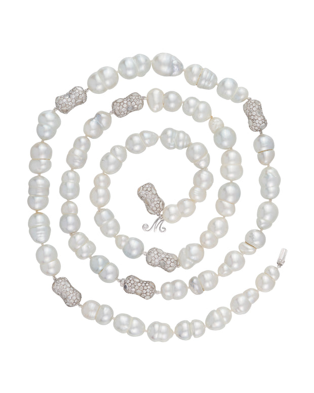 """Snowmen"" South Sea pearl necklace with diamond and moonstone 'peanut' enhancers, crafted in 18 karat white gold."