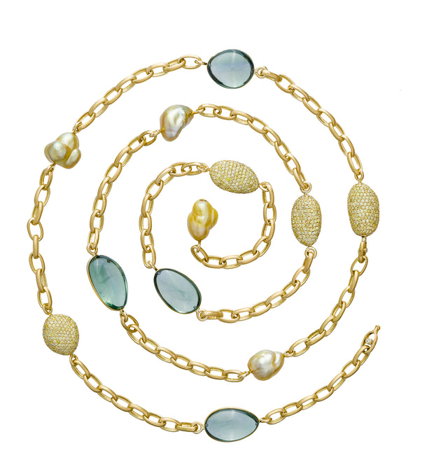 Gold chain necklace with golden pearls, green amethyst pebbles and diamond pave pebbles, crafted in 18 karat yellow gold chain.
