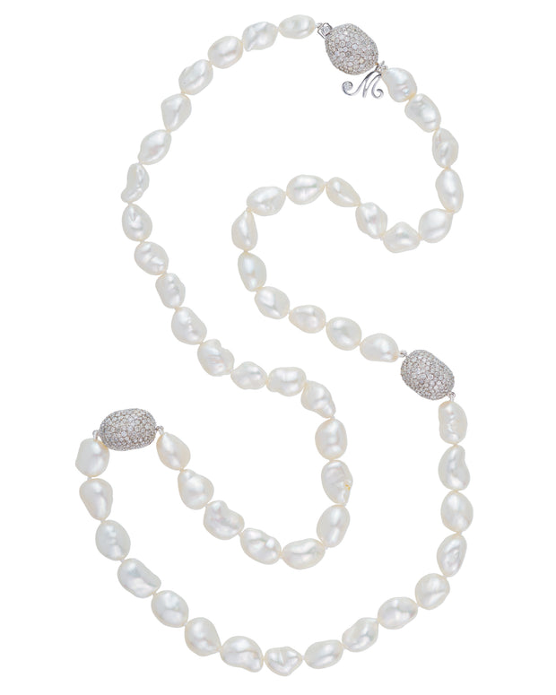 South Sea Keshi pearl necklace featuring South Sea Keshi pearls with 'pebbles' set in with diamonds, crafted in 18 karat white gold.