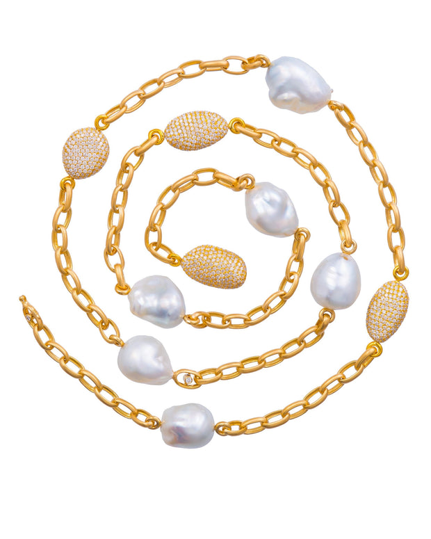 South Sea pearl and diamond necklace featuring Australian baroque pearls and pave diamond beads set diamonds, crafted in 18 karat yellow gold.