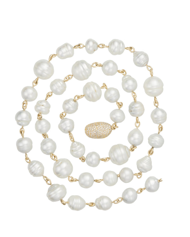South Sea pearl necklace featuring grey white and golden tone Australian baroque pearls and pave diamond pebble set with diamonds, crafted 18 karat yellow gold.