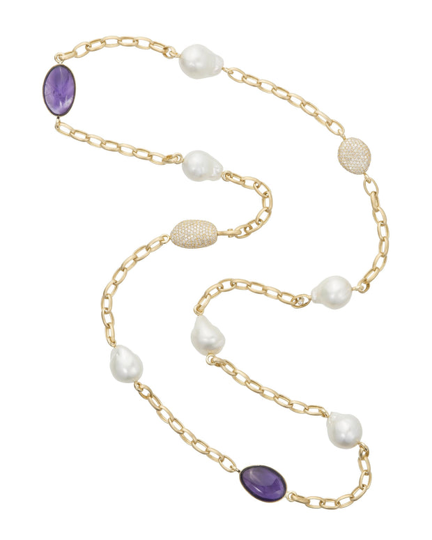 South Sea pearl, diamond and amethyst necklace featuring Australian baroque South Sea pearls, amethyst 'pebbles' and diamond 'pebbles' set with diamonds, crafted in 18 karat yellow gold.