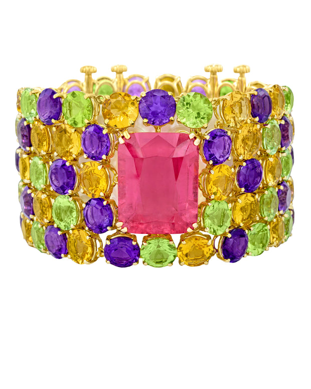"""Tutti Frutti"" cuff featuring a center NYC rubellite, with yellow beryl, amethyst and peridot, crafted in 18 karat yellow gold."