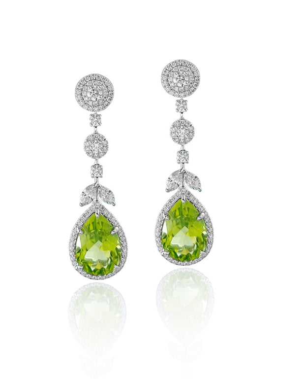 Pear cut peridot and diamond drop earrings, crafted in 18 karat white gold.