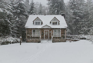 house during winter and snow storm