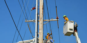 two utility workers working on power lines