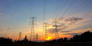electrical utility poles and lines during sunrise