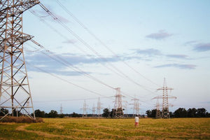 power lines and transformers delivering electricity across vast distance