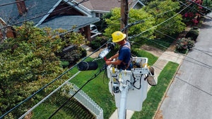 utility worker repairing power line