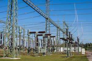 power substation protected from critters with line guard and pole guard systems