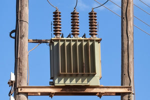 distribution transformer mounted to utility pole