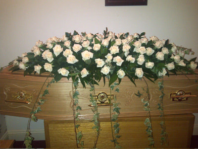 coffin spray  champagne roses