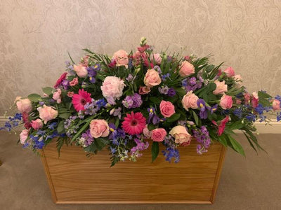 coffin spray  purple pinks and lilacs