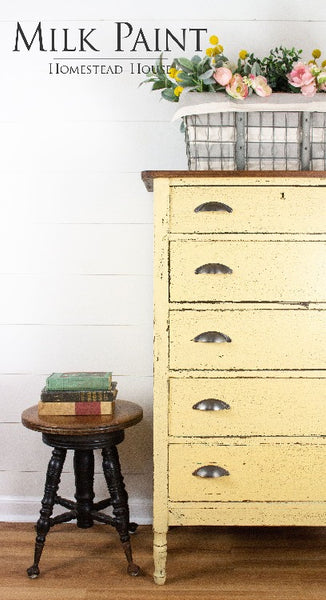 Milk Paint Homestead House | Ochre painted dresser in bedroom setting.