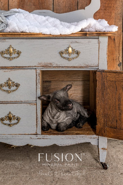 Fusion Mineral Paint | Small lamb sitting in door of baby changing table painted with little lamb.