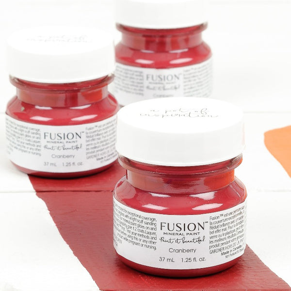 Fusion Mineral Paint | Three small jars of Cranberry on a white background with a paint streak down the middle.