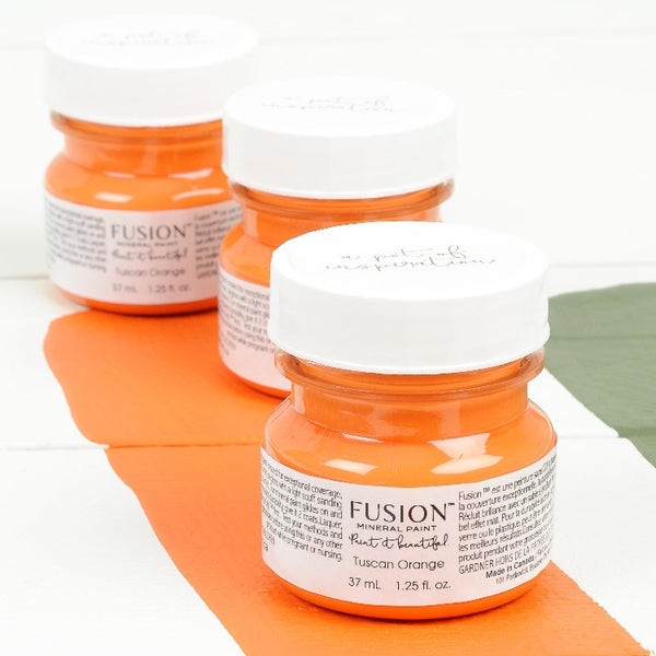 Fusion Mineral Paint | Three small jars of Tuscan Orange on a white background with a paint streak down the middle.