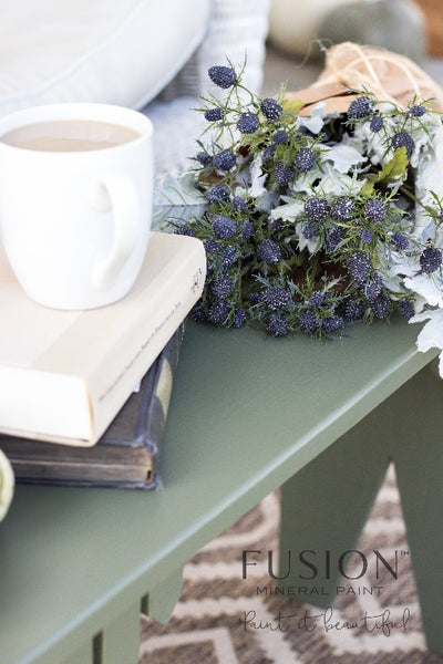 Fusion Mineral Paint | French Eggshell painted table with books and a bouquet of flowers on top.