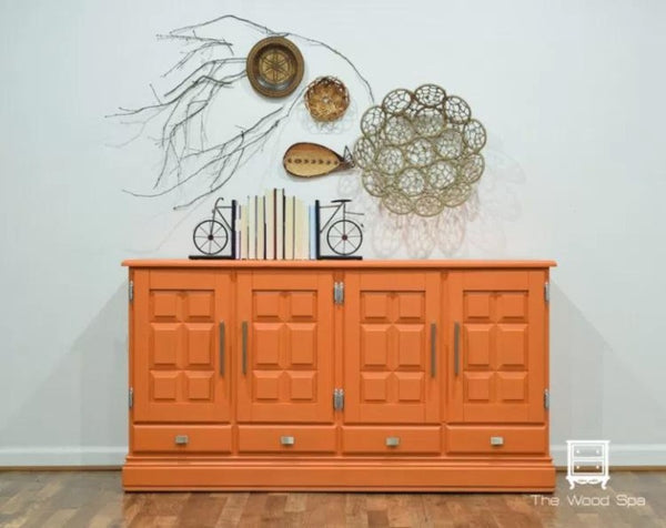 Fusion Mineral Paint | Tuscan Orange painted dresser in front of a white wall with other decor.