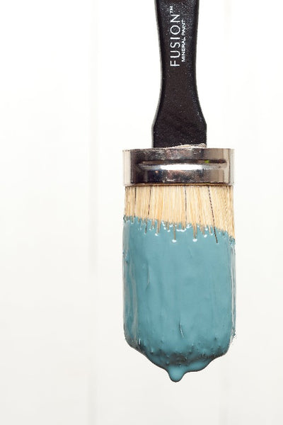 Fusion Mineral Paint | Round paint brush dipped in homestead blue.