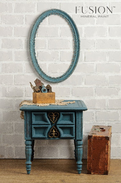 Fusion Mineral Paint | Table and frame painted with homestead blue surrounded by other decor.