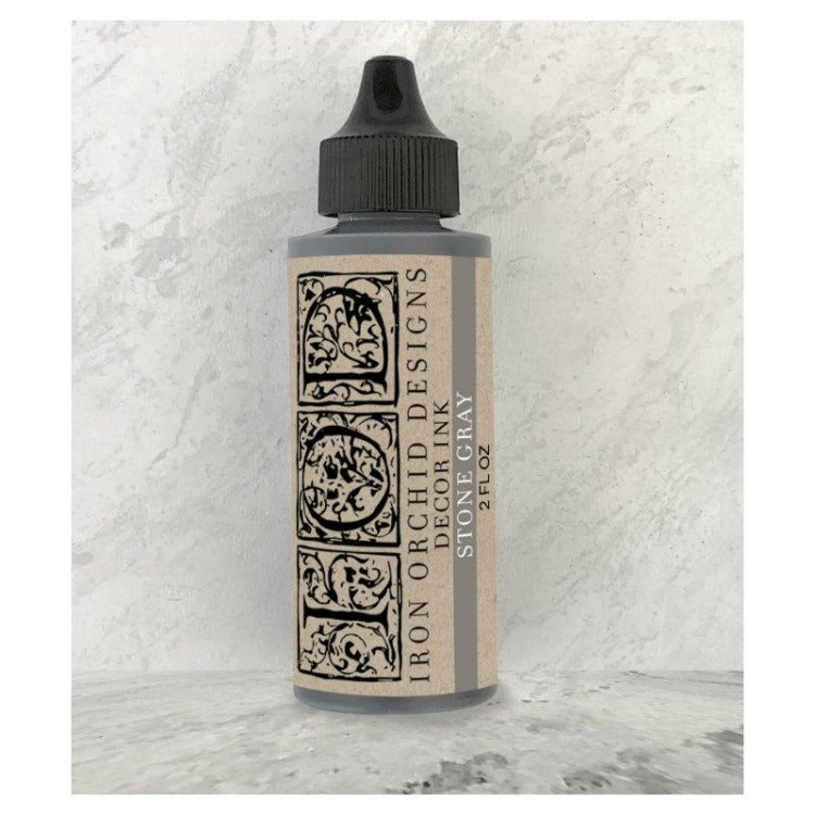 Iron Orchid Design | Stone Gray Ink bottle on marbled background.