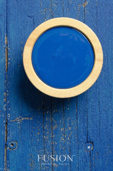 Fusion Mineral Paint | Liberty Blue painted background with a wooden bowl filled with paint.