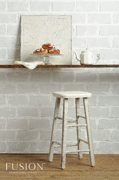 Fusion Mineral Paint | Countertop with decor along white brick wall