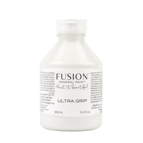 Fusion Mineral Paint | Ultra Grip Bonding Agent bottle on white background.