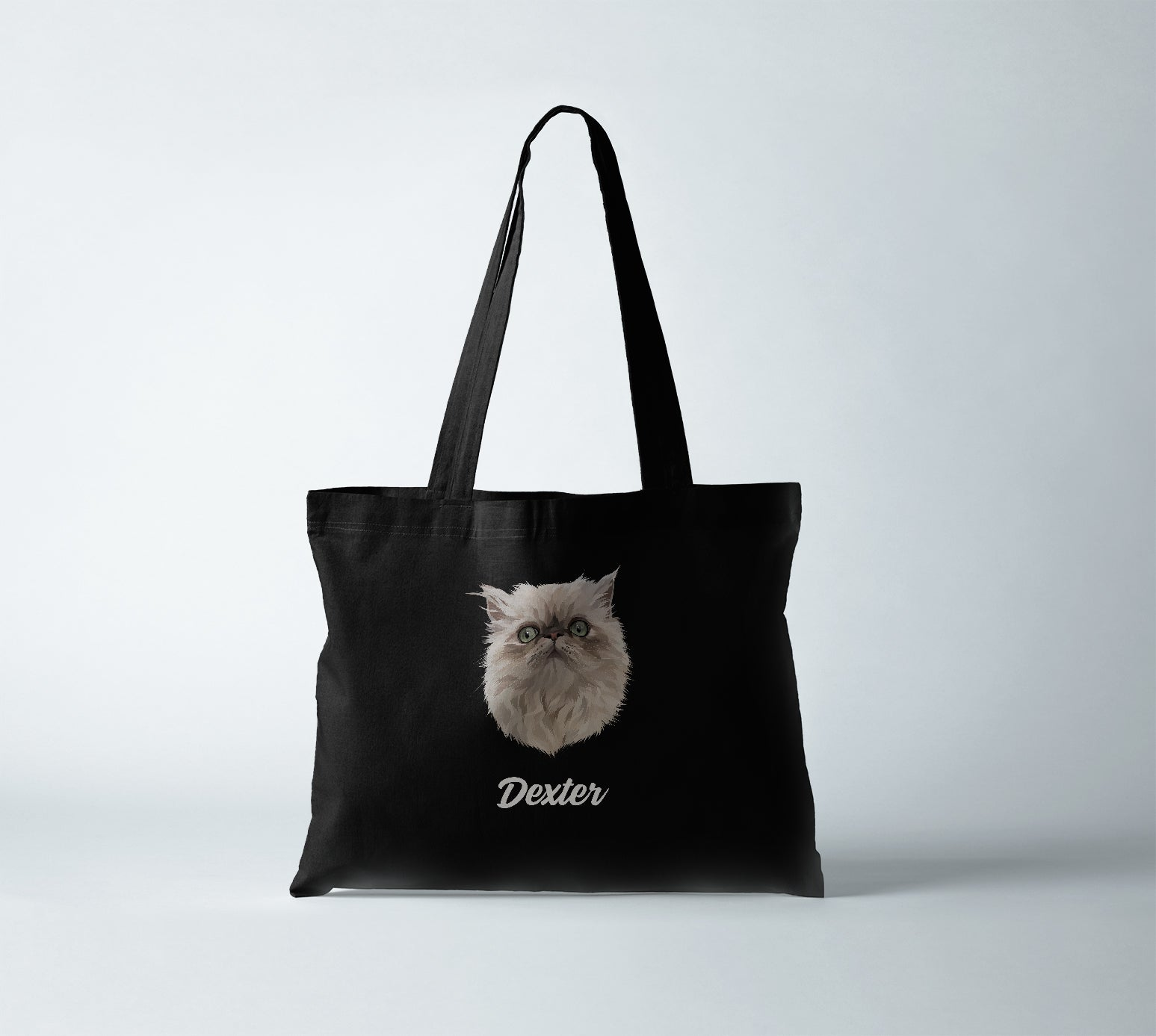 100% certified organic canvas tote bag in jet black, with personalized pet portrait of a cat with its name in white.