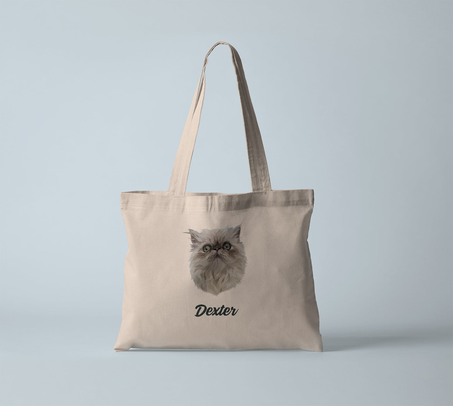 Canvas tote bag in natural tan, with personalized pet portrait of a cat with its name in black.