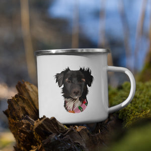 Custom pet portrait of a dog on a white enamel mug with a silver rim. Enamel mug is placed on a wooden log in nature.