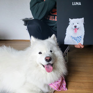 Custom pet art portrat of Luna the Samoyed. Her poratrit is printed in our Onyx Black background along with her personalized name. Luna is laying down beside her poster that is being held up by her owner.