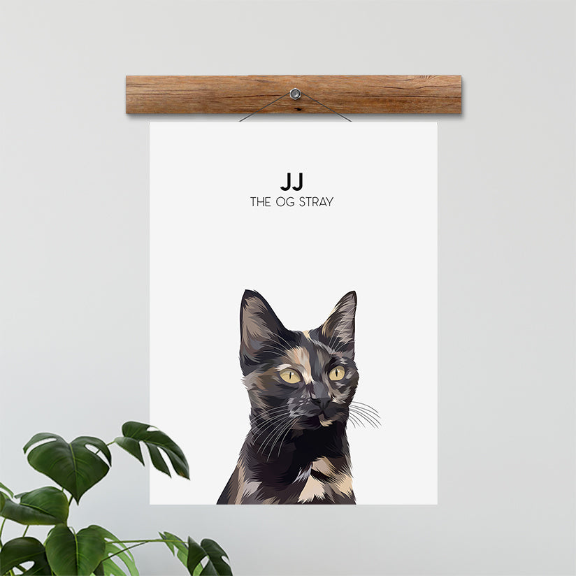 Custom hand illustrated pet portrait of a cat named JJ with custimized text underneath it's name. The cat portrait is printed on our Cloud White poster and hung up.