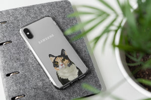 Custom illustration of a cat on a Samsung phone case. The custom cat portrait is placed ontop of a notebook.