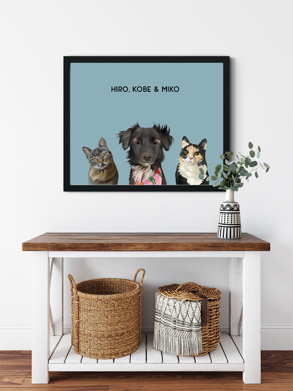 Trio custom framed pet portrait of a cat, dog and cat on ocean blue background with black frame. Personalized name of cat, dog and cat in black font.