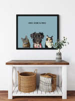 Load image into Gallery viewer, Trio custom framed pet portrait of a cat, dog and cat on ocean blue background with black frame. Personalized name of cat, dog and cat in black font.