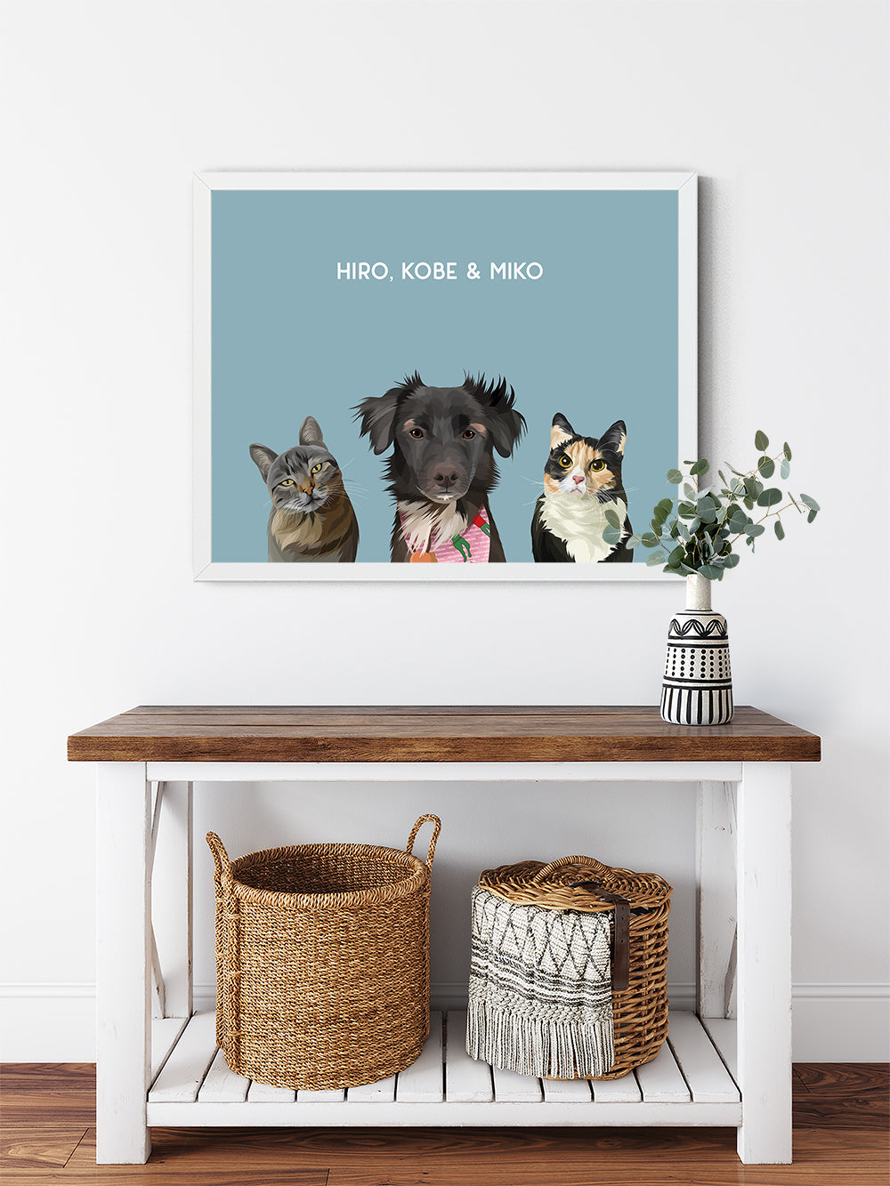 Trio custom framed pet portrait of a cat, dog and cat on ocean blue background with white frame. Personalized name of cat, dog and cat in white font.