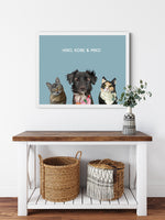 Load image into Gallery viewer, Trio custom framed pet portrait of a cat, dog and cat on ocean blue background with white frame. Personalized name of cat, dog and cat in white font.