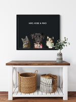 Load image into Gallery viewer, Trio custom framed pet portrait of a cat, dog and cat on onyx black background with black frame. Personalized name of cat, dog and cat in white font.