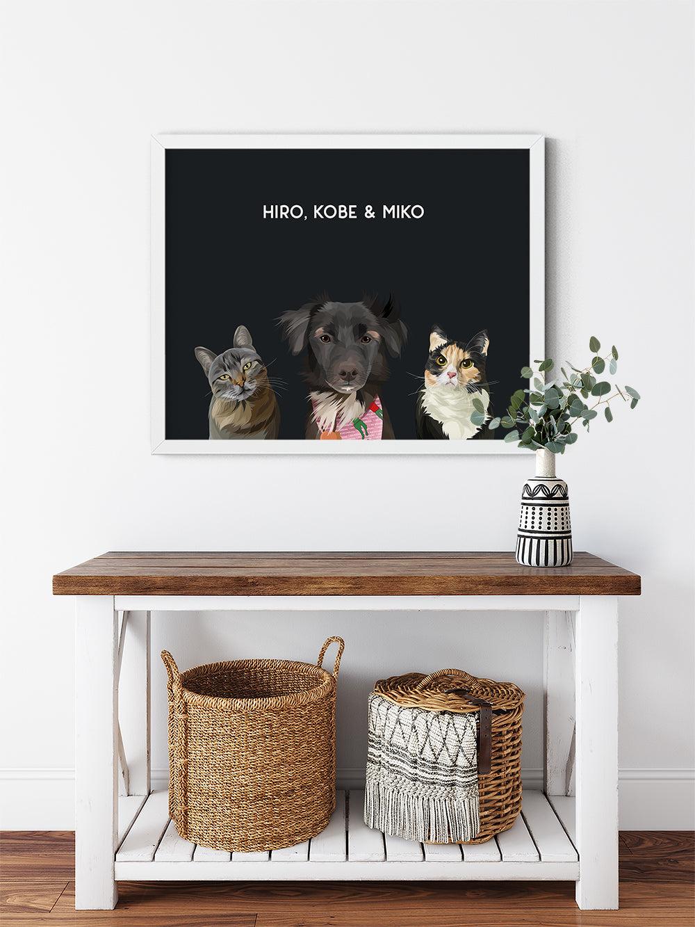 Trio custom framed pet portrait of a cat, dog and cat on onyx black background with white frame. Personalized name of cat, dog and cat in white font.