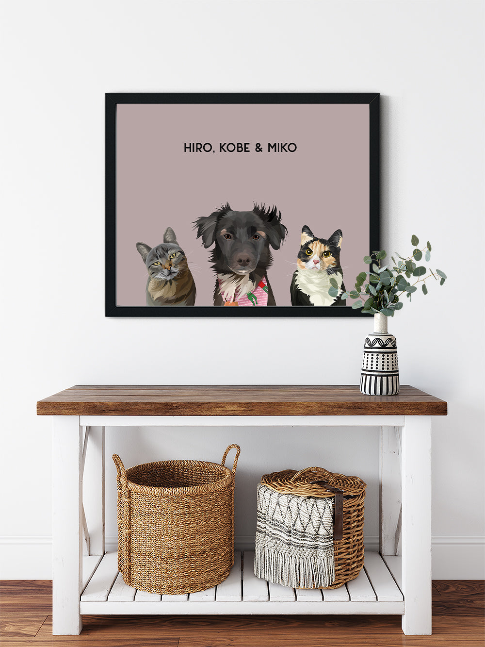 Trio custom framed pet portrait of a cat, dog and cat on blush pink background with black frame. Personalized name of cat, dog and cat in black font.