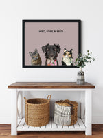 Load image into Gallery viewer, Trio custom framed pet portrait of a cat, dog and cat on blush pink background with black frame. Personalized name of cat, dog and cat in black font.