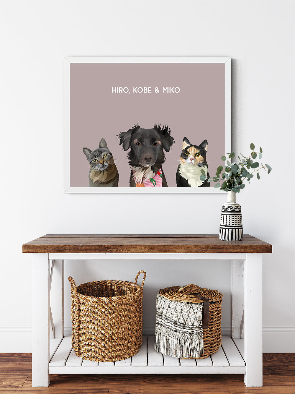 Trio custom framed pet portrait of a cat, dog and cat on blush pink background with white frame. Personalized name of cat, dog and cat in white font.
