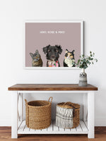 Load image into Gallery viewer, Trio custom framed pet portrait of a cat, dog and cat on blush pink background with white frame. Personalized name of cat, dog and cat in white font.