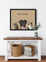Load image into Gallery viewer, Trio custom framed pet portrait of a cat, dog and cat on desert sand background with black frame. Personalized name of cat, dog and cat in black font.