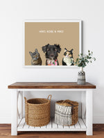Load image into Gallery viewer, Trio custom framed pet portrait of a cat, dog and cat on desert sand background with white frame. Personalized name of cat, dog and cat in white font.
