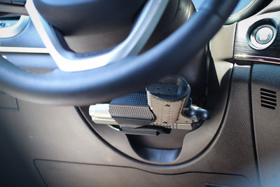 Universal gun holster mounted under the steering wheel.