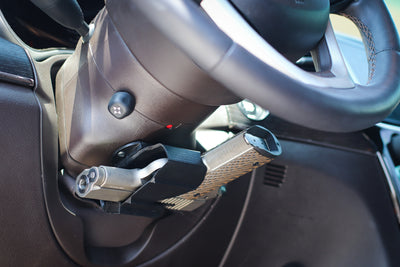 Universal holster mounted under steering wheel